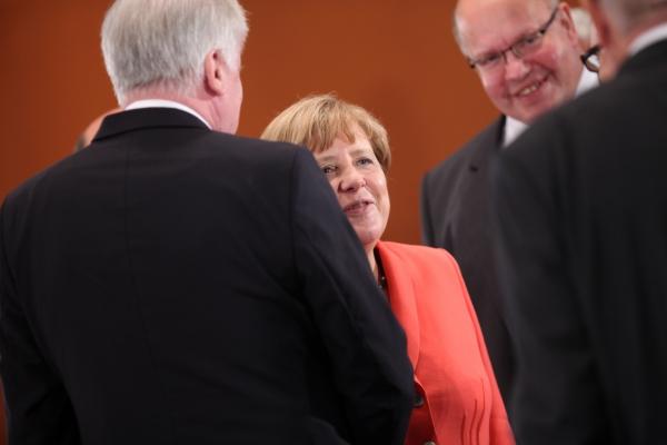 Horst Seehofer, Angela Merkel und Peter Altmaier, über dts Nachrichtenagentur
